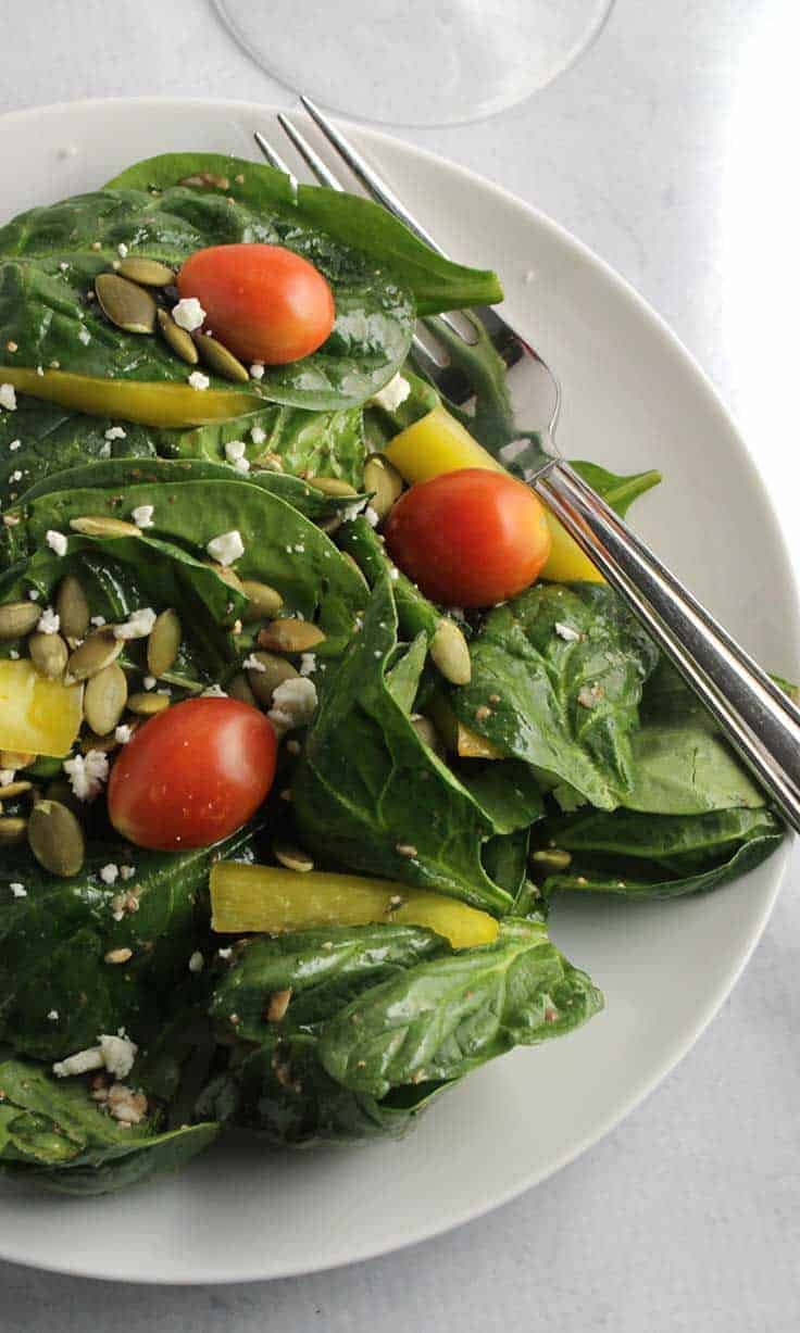 tasty spinach salad tossed with a very simple vinaigrette is a healthy part of any meal.