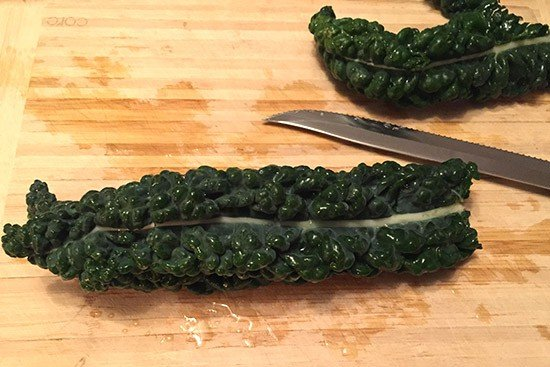 preparing Tuscan kale, also known as lacinato kale or dinosaur kale.