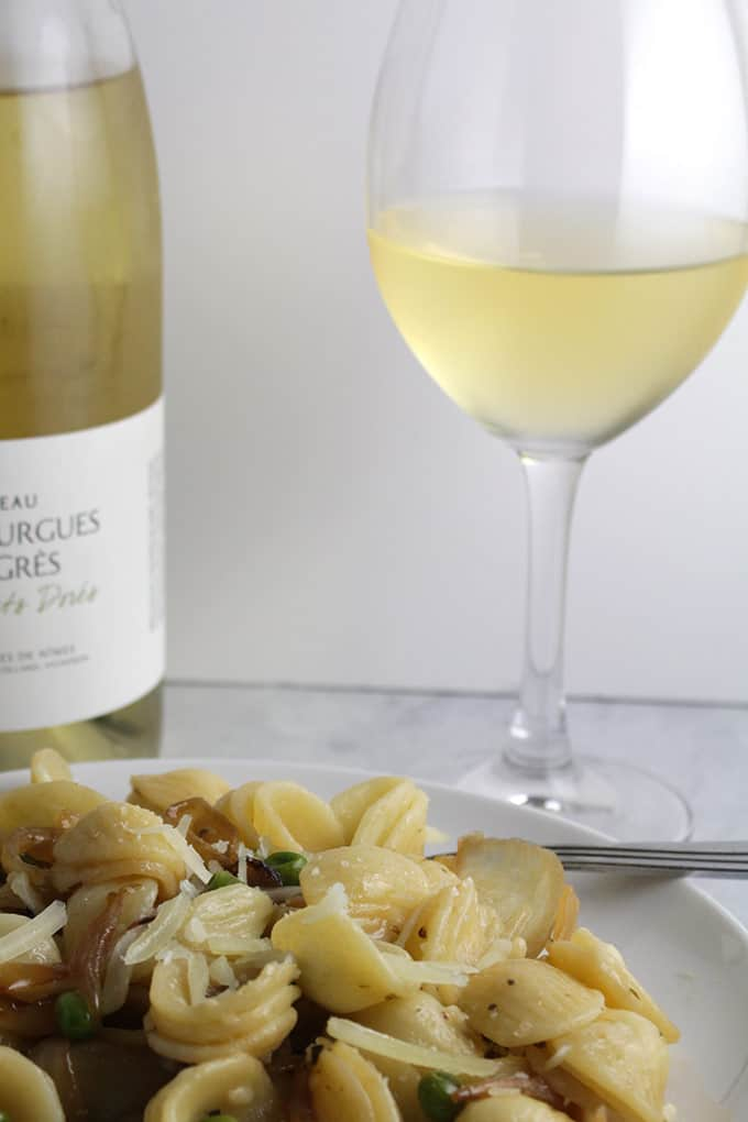 A white Rhone wine pairs well with orecchiette with peas, pecorino and onions.