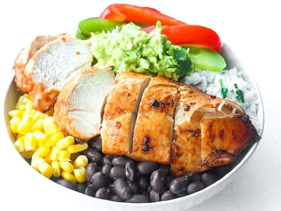 Chipotle Chicken Burrito Bowl from Ahead of Time, picked for grilled onions and peppers roundup.