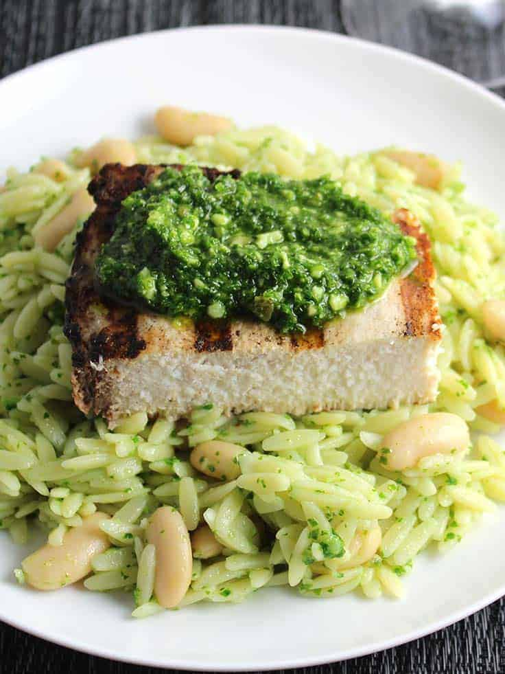 plate of orzo with grilled swordfish and kale pesto.