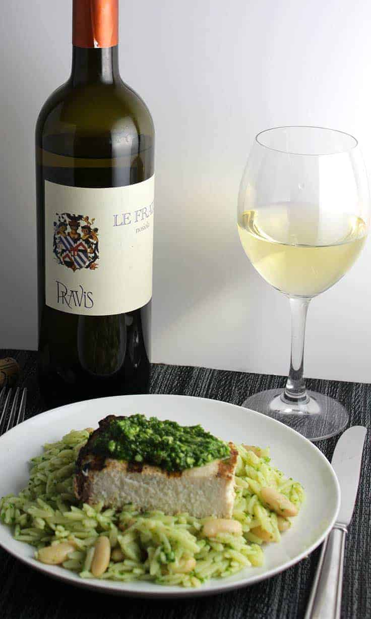 orzo with grilled swordfish and kale pesto paired with a white wine.