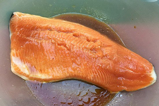 arctic char marinating before grilling.