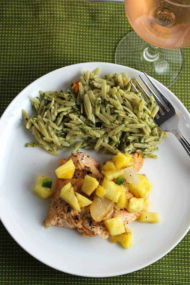 Grilled Arctic Char with Pineapple Salsa, a flavorful seafood recipe that is delicious served with a rosé wine.