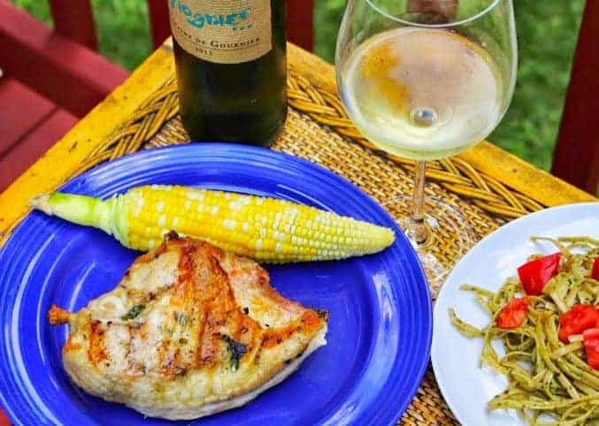 grilled chicken breasts with garlic basil butter.