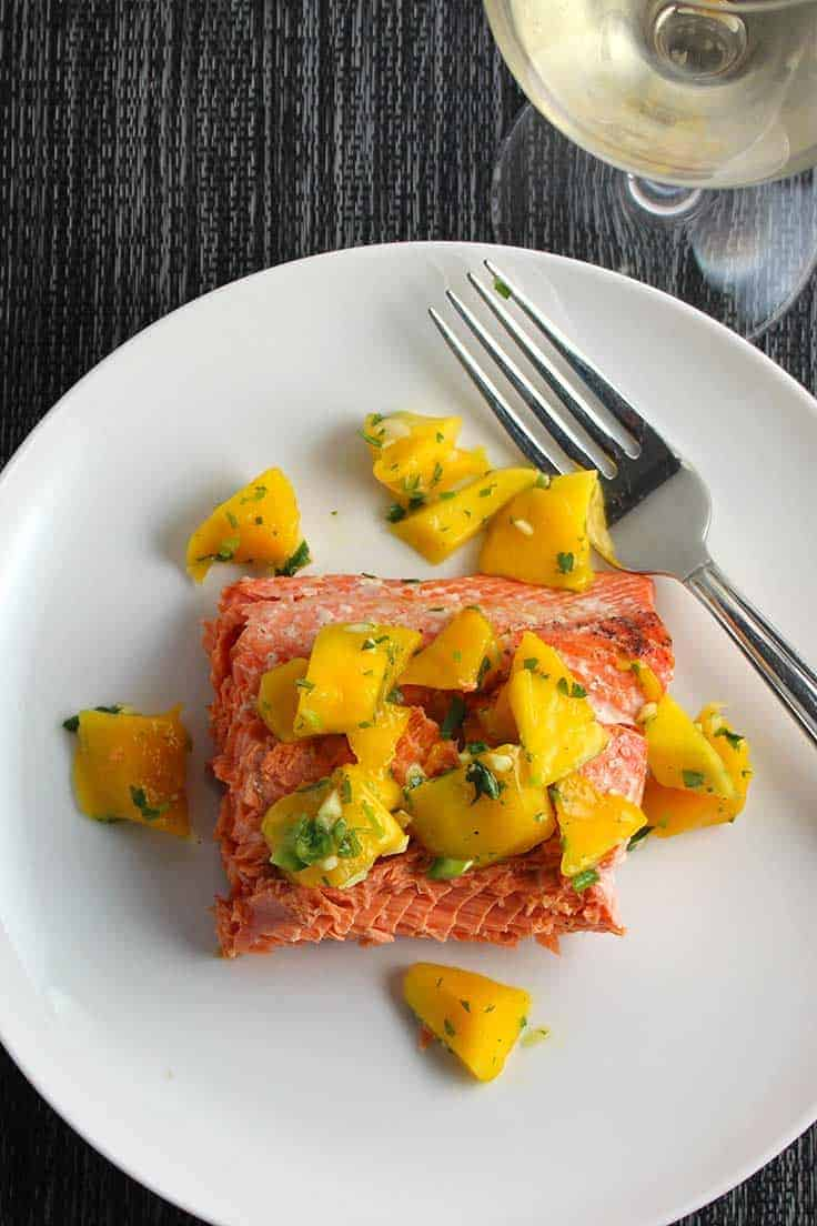 Grilled Salmon topped with Mango Salsa, served with a White Burgundy.