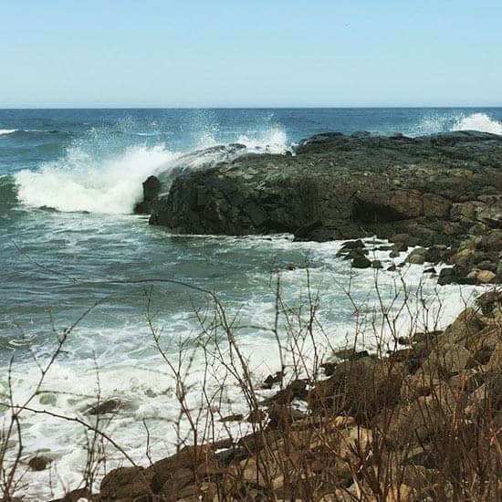 waves crashing against the rocks by the Marginal Way in Ogunquit, Maine.