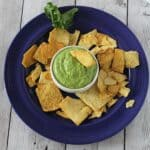 plate with kale pesto dips and chips.