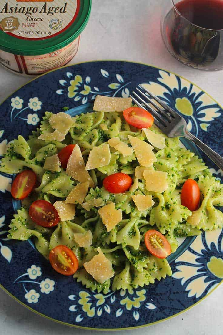 bow tie pasta tossed with kale pesto and Stella asiago cheese, an easy recipe to try for your holiday entertaining.