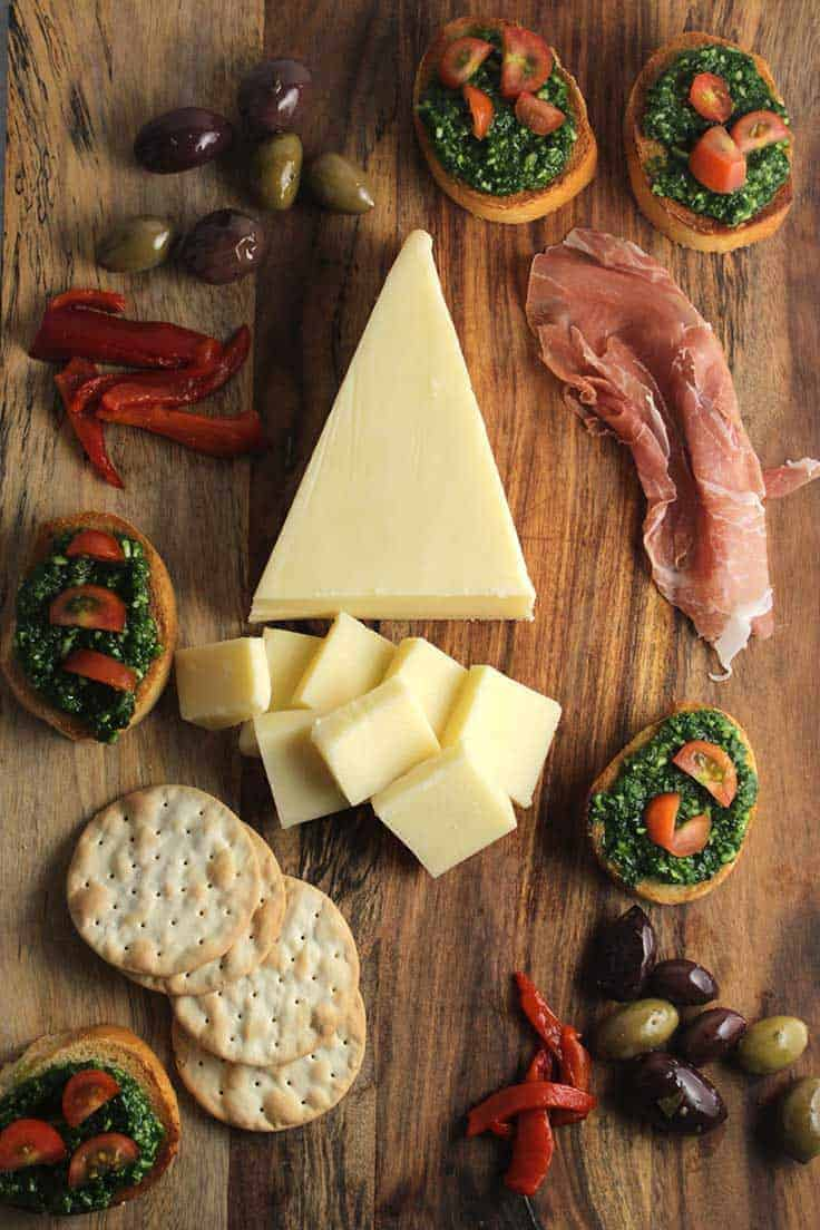 Make an Easy Holiday Cheese Board with @StellaCheese and Kale Pesto Crostini.