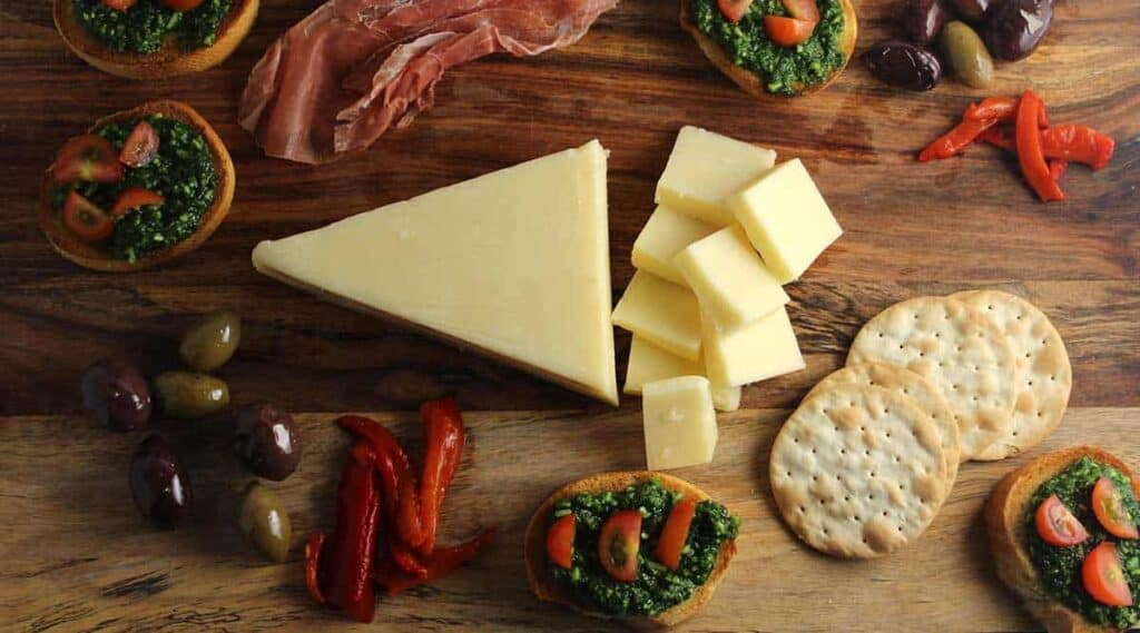 Easy Holiday Cheeseboard with Kale Pesto Crostini