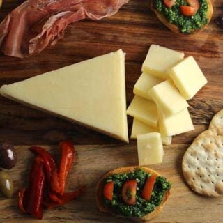 Easy Holiday Cheese Board with Kale Pesto Crostini
