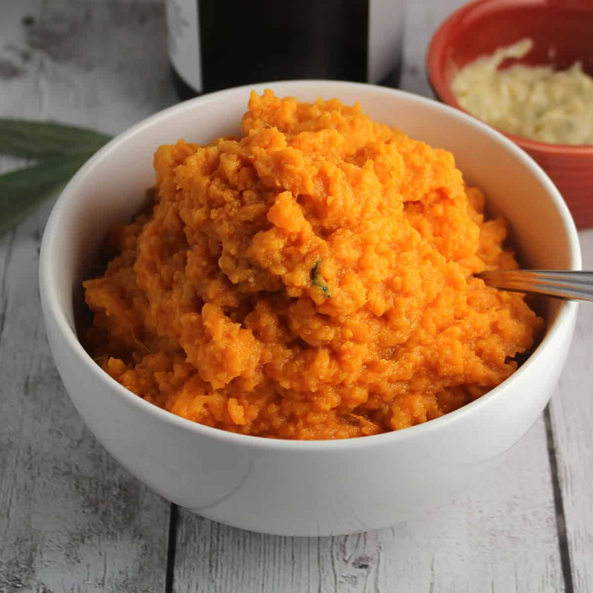 mashed sweet potatoes in a white bowl.