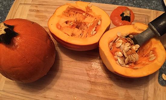 preparing sugar pumpkins for roasting.
