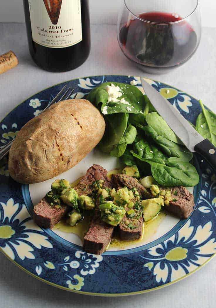 roasted sirloin steak topped with a delicious avocado sauce recipe, served with a Cabernet Franc wine.