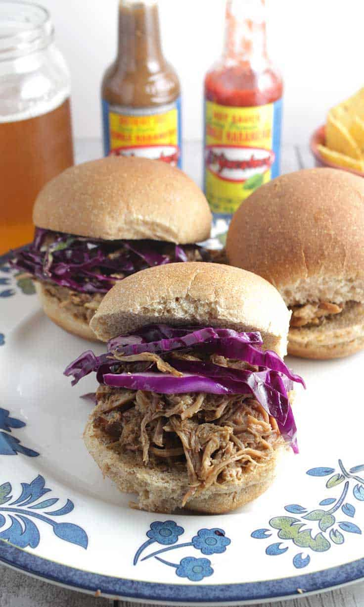 Spicy Pulled Pork Slides recipe featuring El Yucateco® hot sauce. Perfect for homegating for a big game!