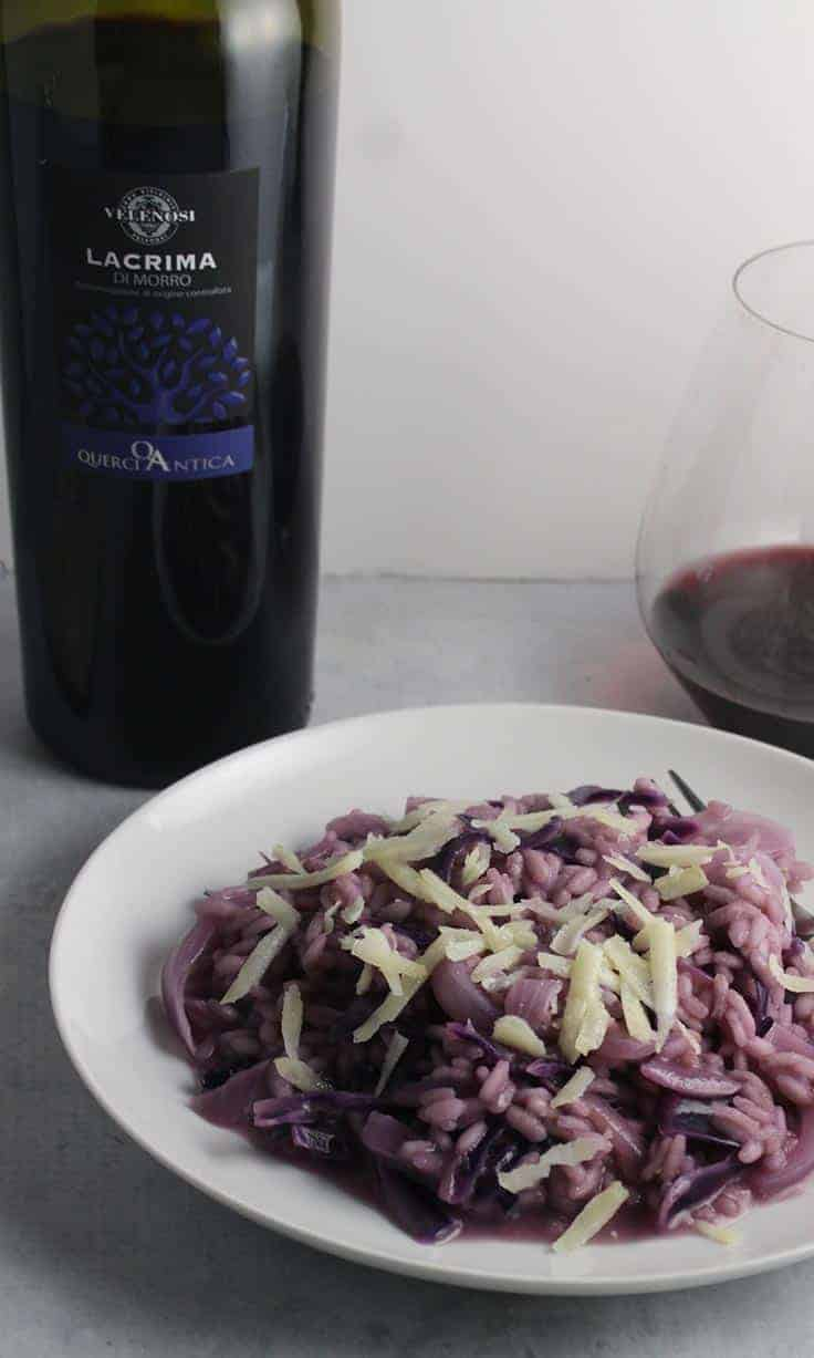 red cabbage risotto paired with a bottle of Lacrima Di Morro red Italian wine.