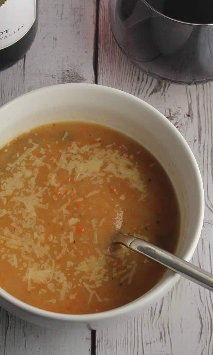 Roasted Root Vegetable Soup recipe, paired with red wine for a comforting dinner.