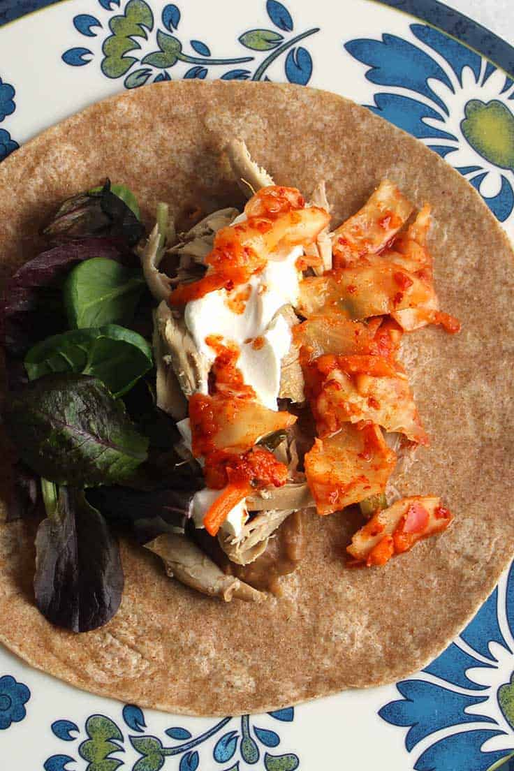 Kimchi gives a spicy crunch to this easy chicken burrito recipe.