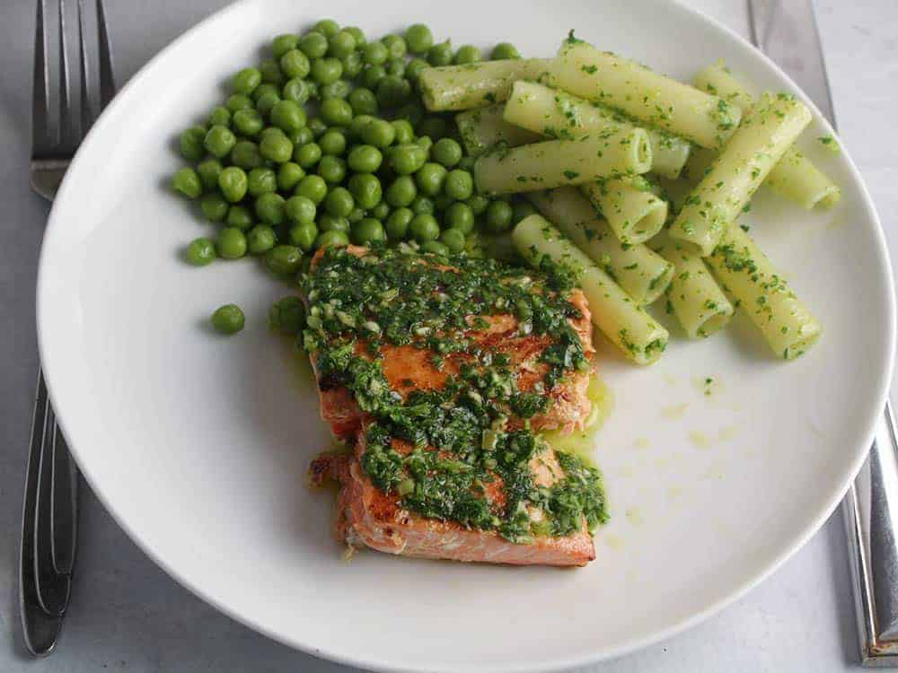 salmon with parsley pesto and a side of peas.