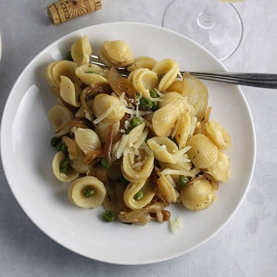 orecchiette with peas, pecorino and onions.