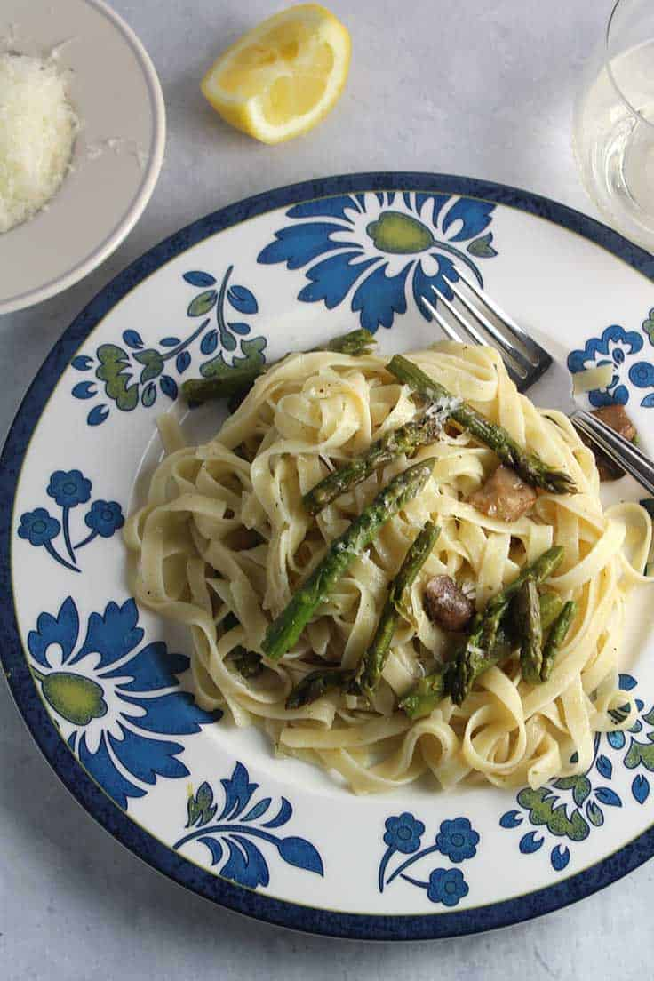 roasted asparagus and mushrooms tossed with fettuccine and cheese for simple and flavorful pasta recipe.