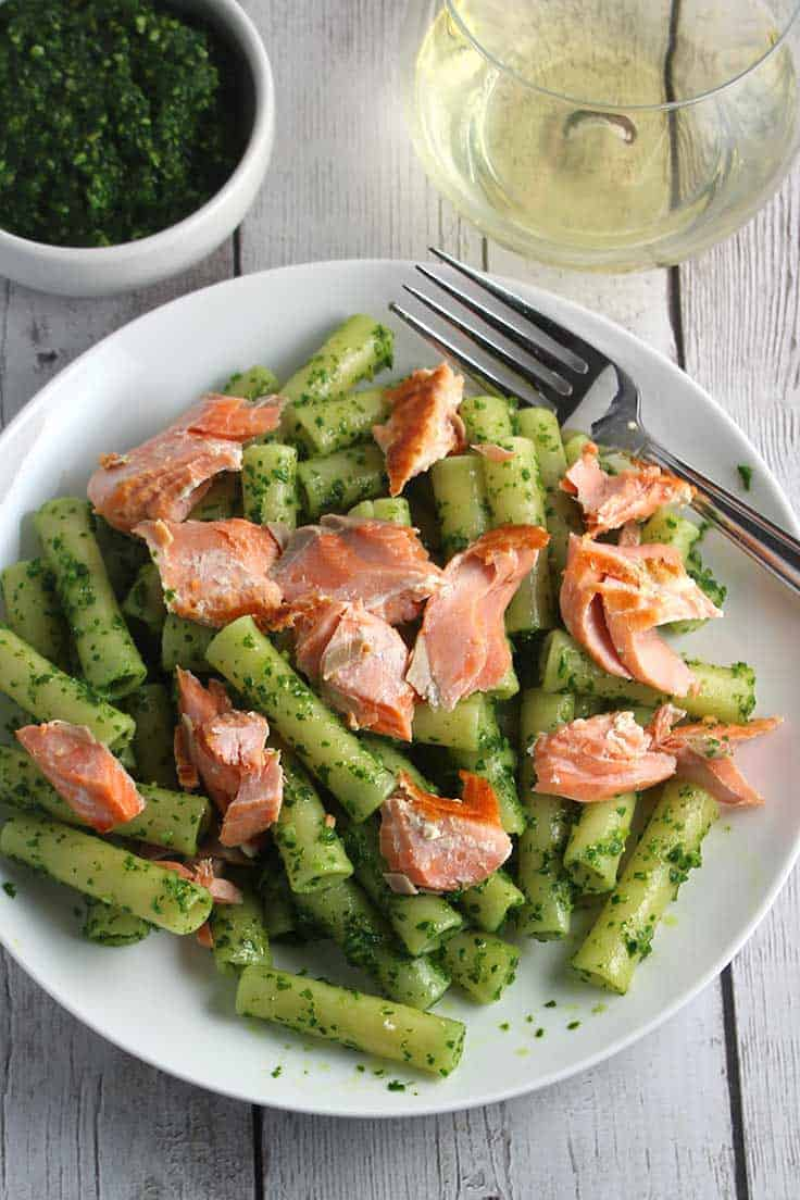 ziti tossed with kale pesto and salmon for a healthy, tasty pasta recipe.