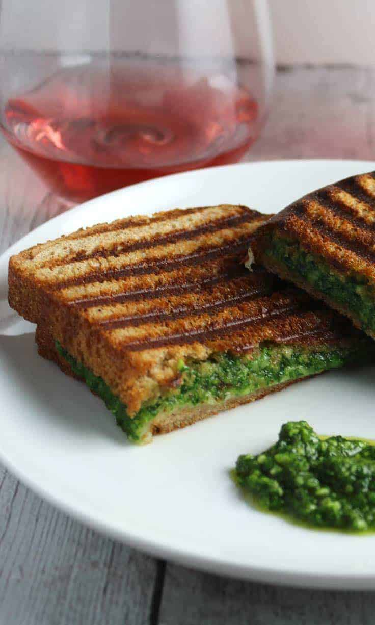 kale pesto grilled cheese is easy to make and full of flavor! serve with a rosé wine for a relaxing weekend lunch.