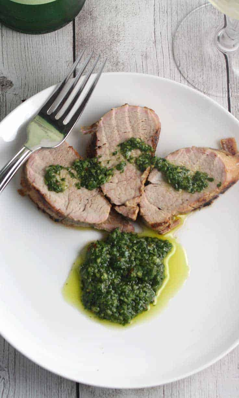 Grilled pork tenderloin recipe with bright, flavorful cilantro pesto. #SundaySupper