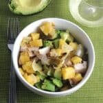 bowl with chicken, avocados and pineapple salsa
