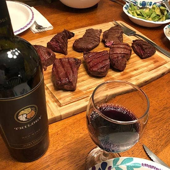 trilogy wine paired with grilled steak.
