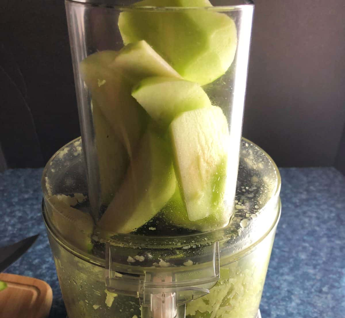 shredding green apples in a food processor