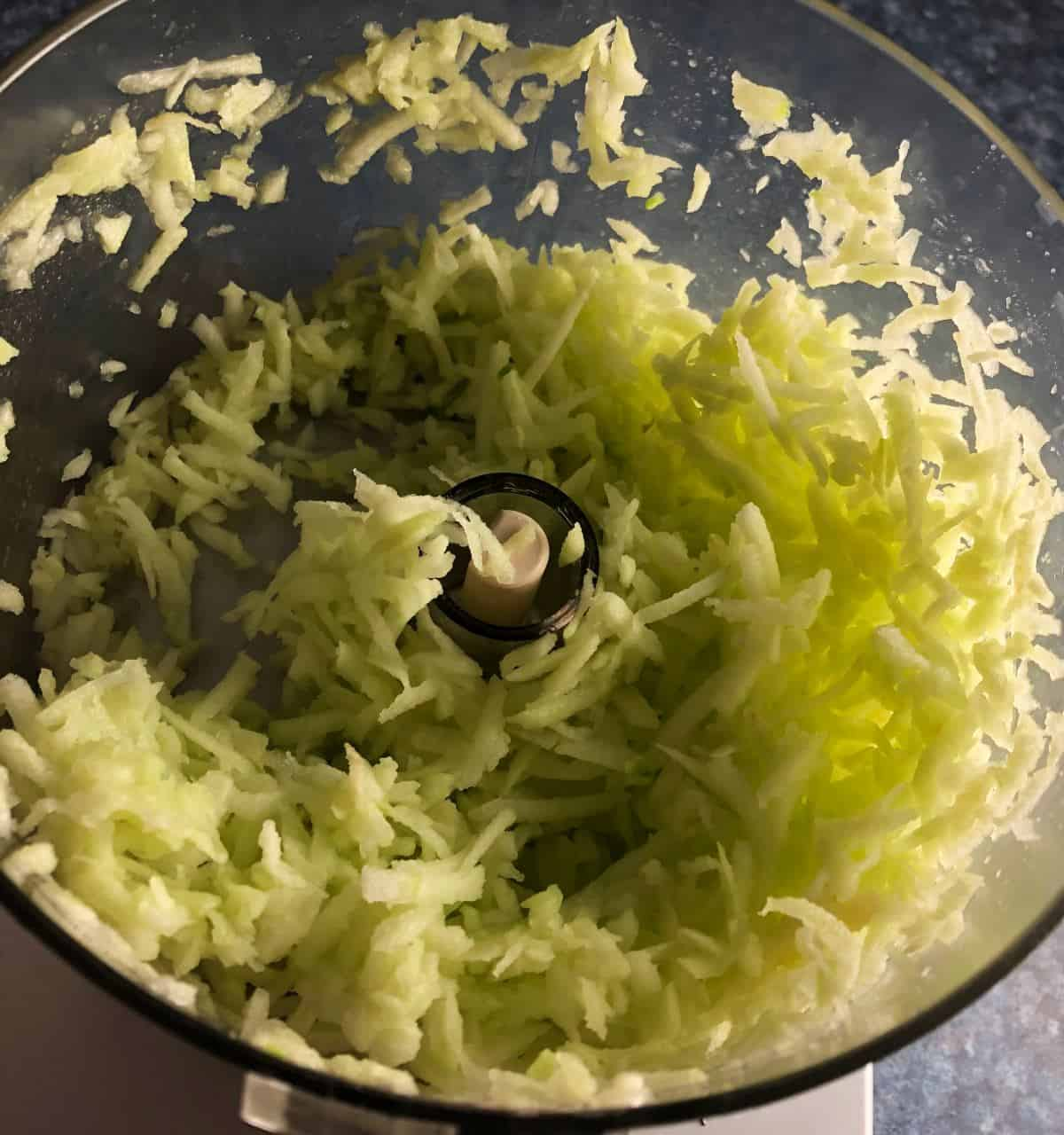 shredded apple in a food processor