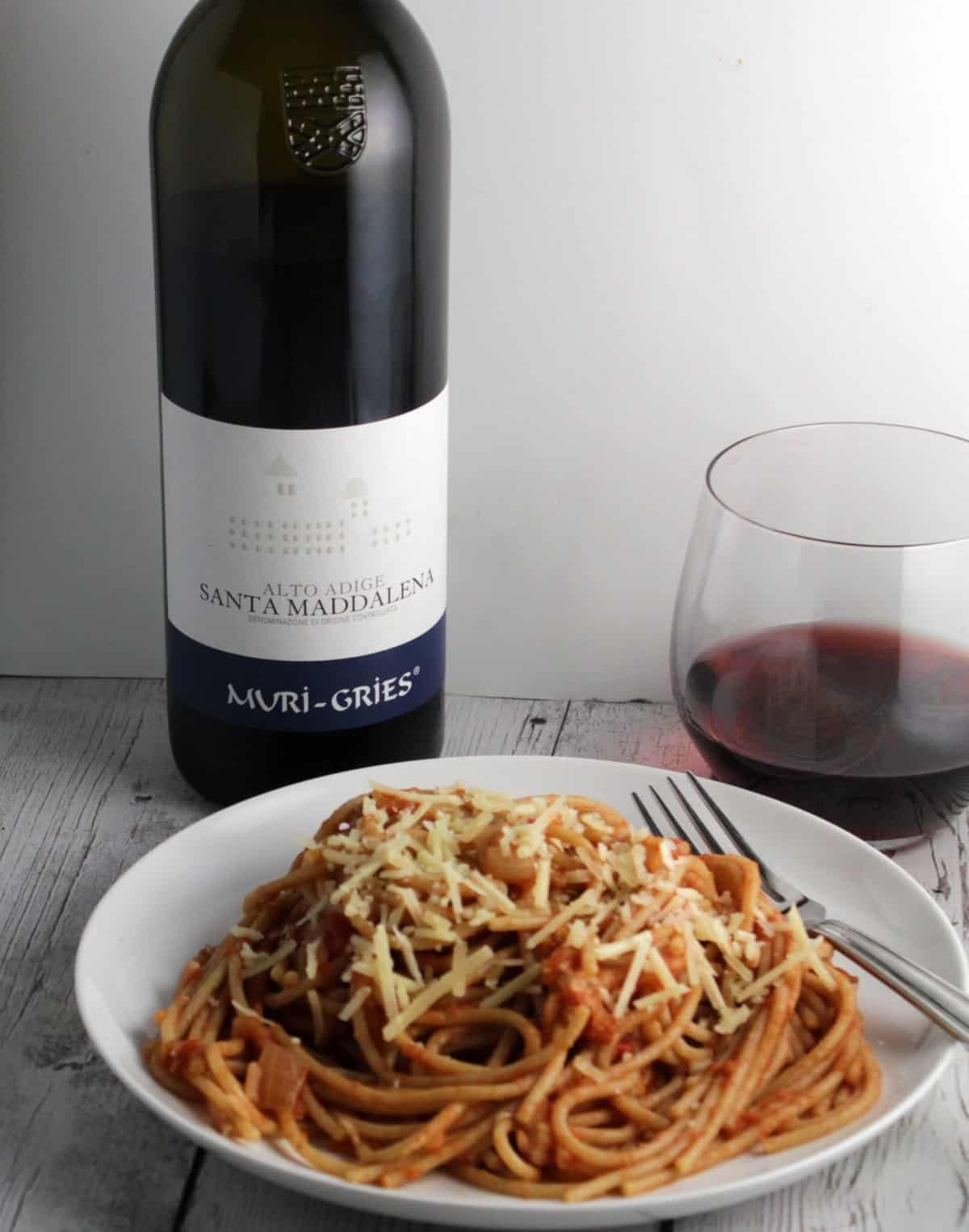 spaghetti with apple tomato sauce and a red wine