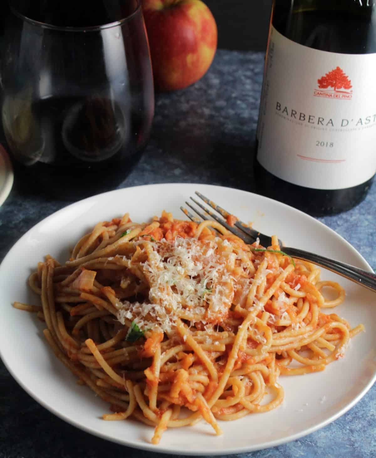 spaghetti with apple tomato sauce served with a Barbera, Italian red wine.