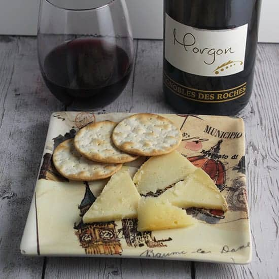 Morgon red wine pairs well with Tomme de Savoie cheese.