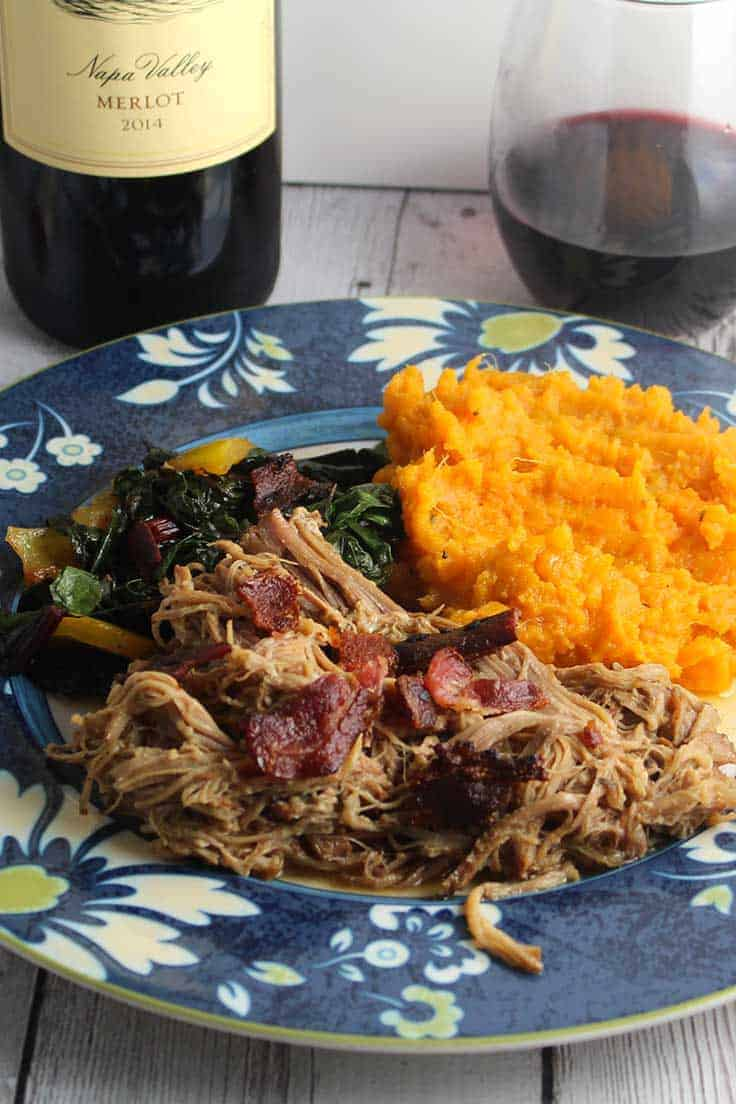 pulled pork with bacon, served with sweet potatoes, greens and a good glass of Merlot. #slowcooker #pulledpork #bacon #Merlot
