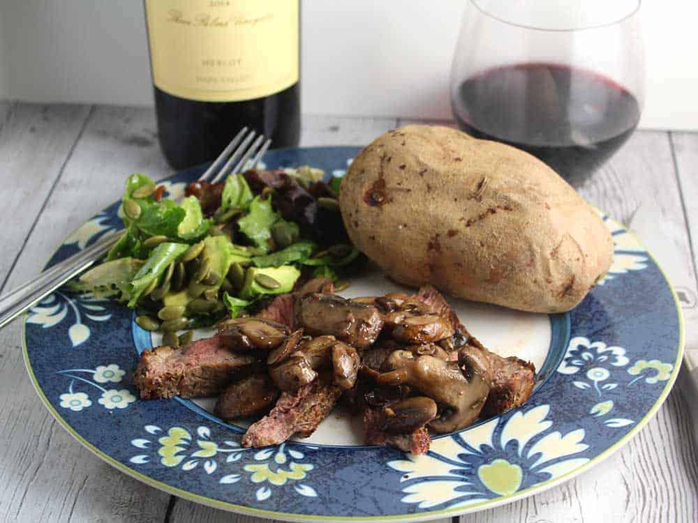 ribeye with mushrooms and a Duckhorn Merlot.
