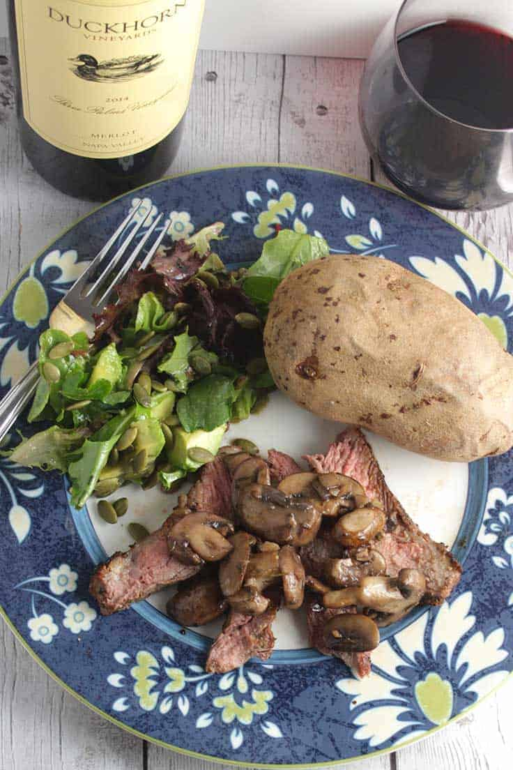 Ribeye steak with mushrooms, paired with a special Merlot wine. #wine #steak