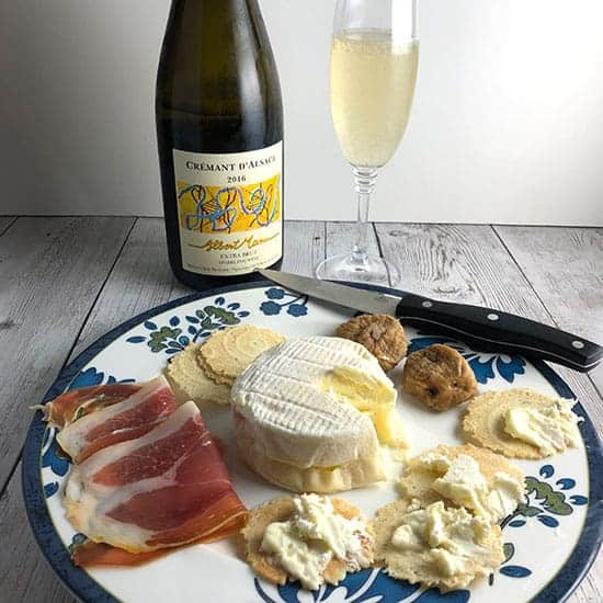 Albert Mann Cremant d'Alsace with a cheese plate.