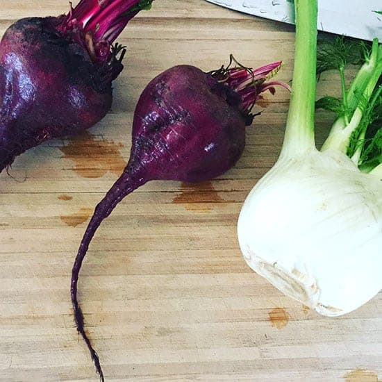 beets and fennel on a cutting board.