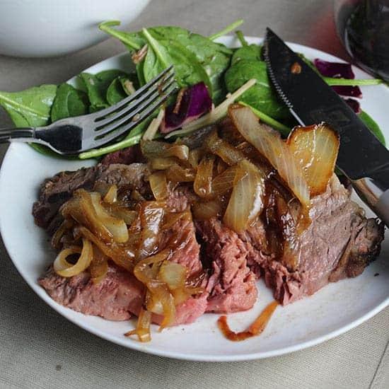 spiced ribeye roast with caramelized onions.