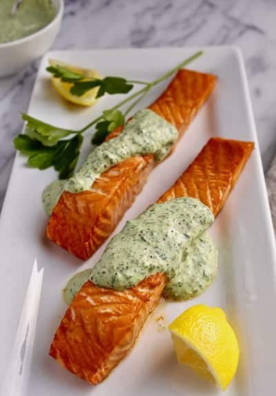 roasted salmon with greens mustard sauce from Best Healthy Salmon Recipes roundup.