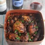Hearty chicken cassoulet recipe with bacon and beans, paired with red wine from the Languedoc region of France.