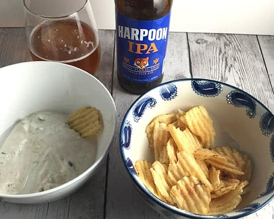Harpoon IPA beer served with spicy green onion dip.