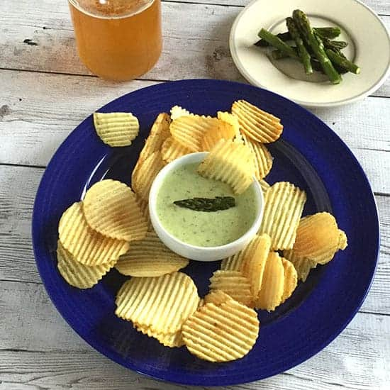 roasted asparagus dip served with a beer.