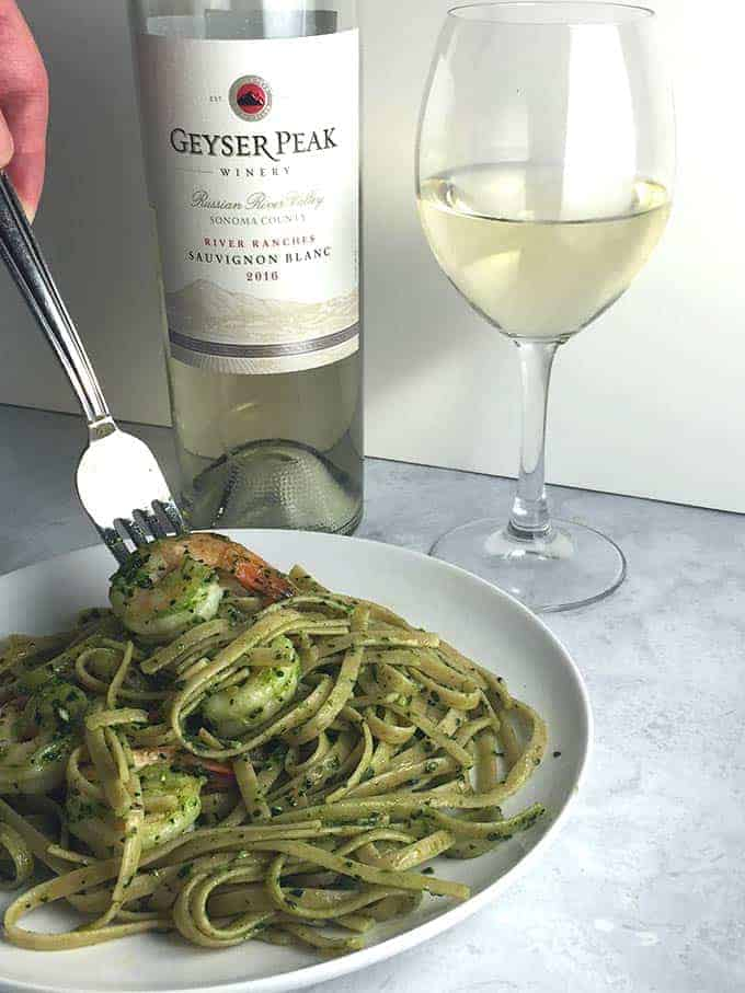 Shrimp Pesto Pasta pairs well with Geyser Peak River Ranches Sauvignon Blanc. #winepairing #SonomaWine #shrimp