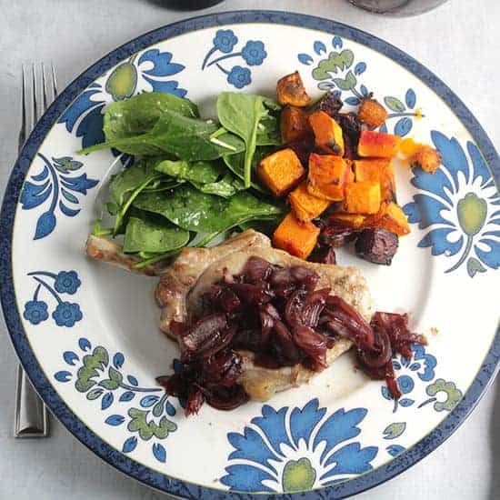 pork chops topped with pomegranate sauce, served with roasted beets, butternut squash and spinach salad.