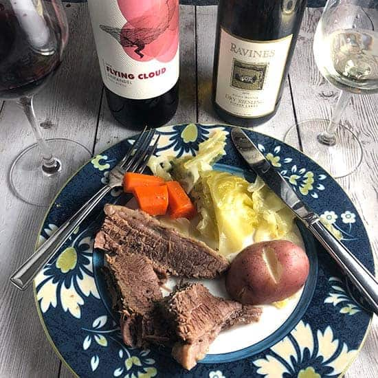 corned beef on a plate served with wine.
