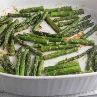Roasted Asparagus with Parmesan in a white baking dish.
